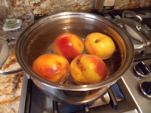 Let peaches sit in boiling-hot water for a minute